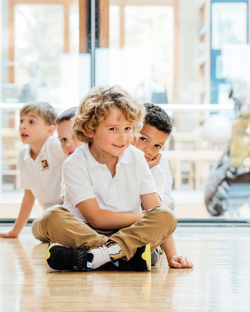 lower school boys sitting on floor
