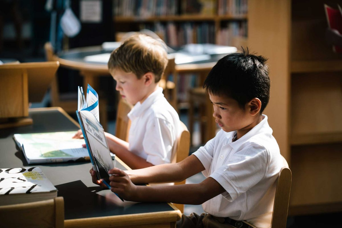 lower school students in library