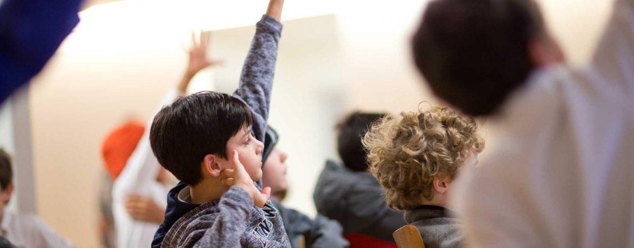 lower school student raising hand